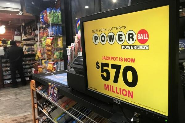 Powerball ticket holders wait for their numbers to be called