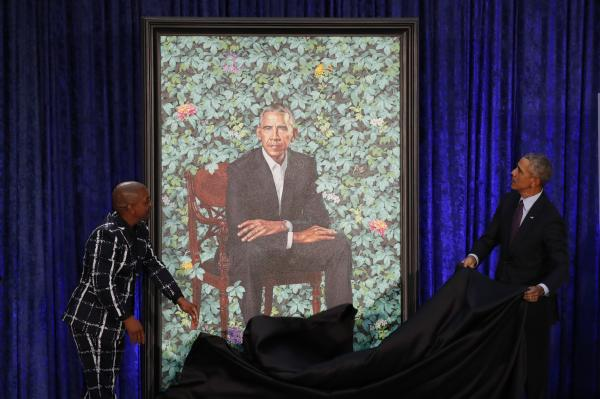 Artist Kehinde Wiley and Barack Obama participate in the unveiling of Obama's portrait. REUTERS  Jim Bourg